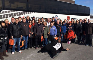 Chicago Bears Fans gather in front of the bus on the Road to the Combine presented by Bridgestone