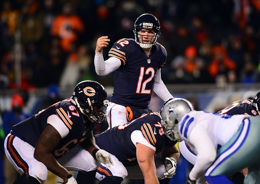 Dec 9, 2013; Chicago, IL, USA; Chicago Bears quarterback Josh McCown (12) gestures at the line of scrimmage during the fourth quarter against the Dallas Cowboys at Soldier Field. Mandatory Credit: Andrew Weber-USA TODAY Sports