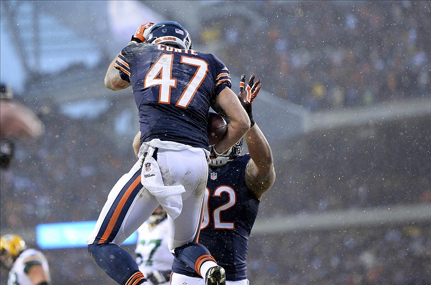 Dec 29, 2013; Chicago, IL, USA; Chicago Bears free safety Chris Conte (47) reacts with defensive tackle Stephen Paea (92) after intercepting a pass during the first quarter against the Green Bay Packers at Soldier Field. Mandatory Credit: Mike DiNovo-USA TODAY Sports