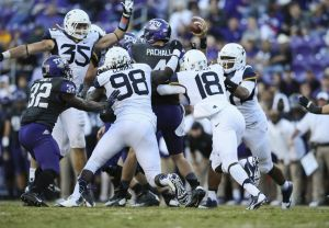 Nov 2, 2013; Fort Worth, TX, USA; TCU Horned Frogs quarterback Casey Pachall (4) is hit by the West Virginia Mountaineers defense and fumbles during the second half at Amon G. Carter Stadium. West Virginia won 30-27 in overtime. Mandatory Credit: Kevin Jairaj-USA TODAY Sports