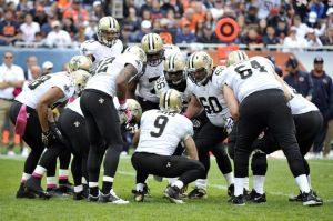 Oct 6, 2013; Chicago, IL, USA; New Orleans Saints quarterback Drew Brees (9) in the huddle during the second half against the Chicago Bears at Soldier Field. The Saints beat the Bears 26-18. Mandatory Credit: Rob Grabowski-USA TODAY Sports