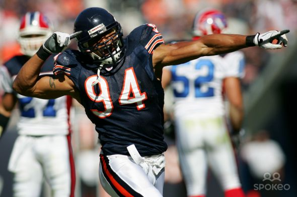 Chicago Bears linebacker (94) Brendon Ayanbadejo celebrates after making a tackle on special teams during the second quarter at Soldier Field in Chicago, IL. The Bears beat the Bills 40-7. MANDATORY CREDIT: USA TODAY Sports Images. All Rights Reserved.
