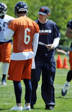 Jun 11, 2013; Lake Forest, IL, USA; Chicago Bears quarterback Jay Cutler (6) talks with head coach Marc Trestman during minicamp at Halas Hall. Mandatory Credit: David Banks-USA TODAY Sports