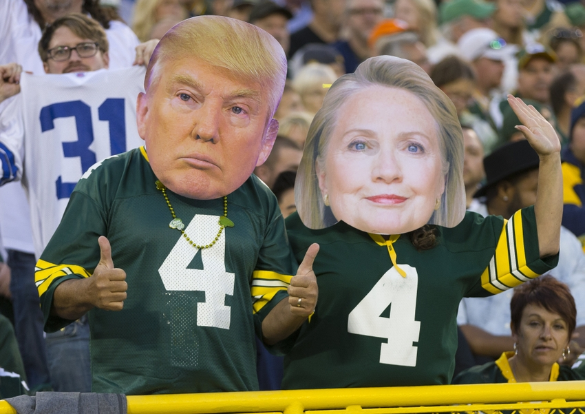 Oct 16, 2016; Green Bay, WI, USA; Green Bay Packers fans wear masks of Donald Trump and Hillary Clinton during the fourth quarter against the Dallas Cowboys at Lambeau Field.  The Cowboys won 30-16. Mandatory Credit: Jeff Hanisch-USA TODAY Sports