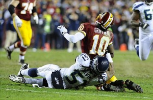 Jan 6, 2013; Landover, MD, USA; Washington Redskins quarterback Robert Griffin III (10) is sacked by Seattle Seahawks defensive end Bruce Irvin (51) during the fourth quarter of the NFC Wild Card playoff game at FedEx Field. Mandatory Credit: Brad Mills-USA TODAY Sports