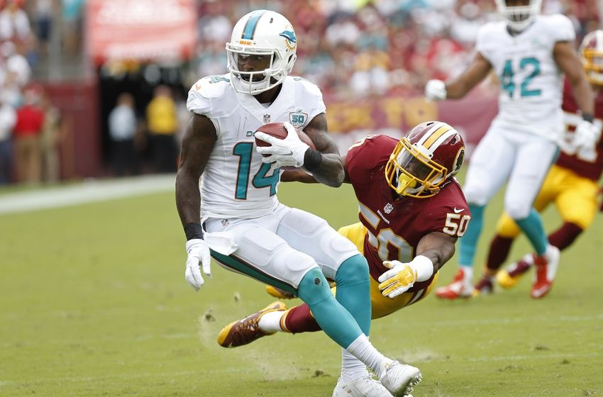 Sep 13, 2015; Landover, MD, USA; Miami Dolphins wide receiver Jarvis Landry (14) runs with the ball as Washington Redskins outside linebacker Martrell Spaight (50) attempts the tackle in the third quarter at FedEx Field. The Dolphins won 17-10. Mandatory Credit: Geoff Burke-USA TODAY Sports