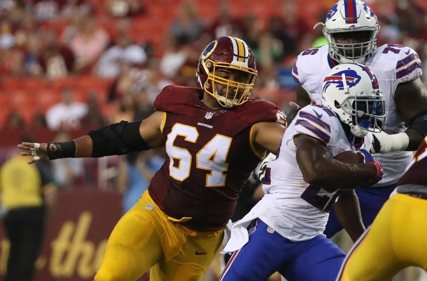 Aug 26, 2016; Landover, MD, USA; Washington Redskins defensive end Kedric Golston (64) attempts to tackle Buffalo Bills running back Reggie Bush (22) at FedEx Field. Mandatory Credit: Geoff Burke-USA TODAY Sports
