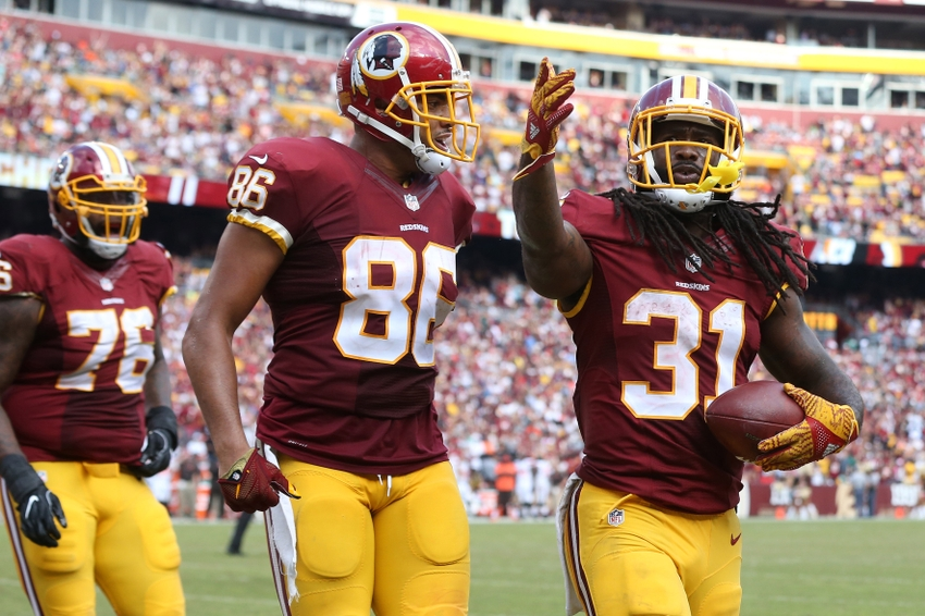 63771dece ... Washington Redskins running back Matt Jones (31) celebrates after  scoring a touchdown against the Cleveland Browns in the fourth quarter at  FedEx Field.