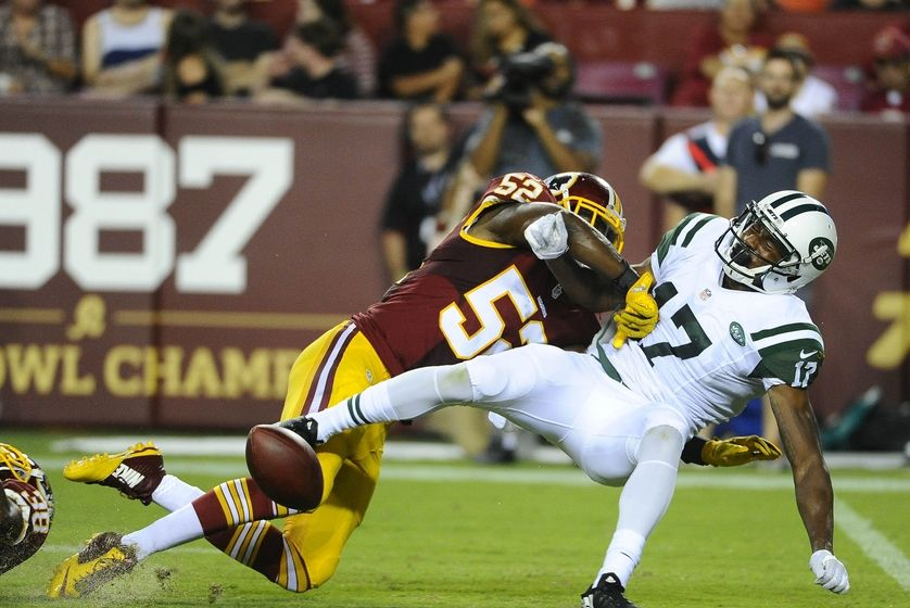 Aug 19, 2016; Landover, MD, USA; Washington Redskins linebacker Terence Garvin (52) breaks up a pass intended for New York Jets wide receiver Charone Peake (17) during the second half at FedEx Field. Mandatory Credit: Brad Mills-USA TODAY Sports