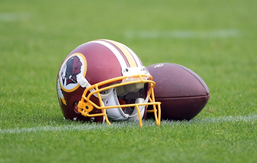 Oct 28, 2016; London United Kingdom; Washington Redskins helmet and football at practice at the Twyford Avenue Sports Ground in preparation for game 17 of the NFL International Series against the Cincinnati Bengals. Mandatory Credit: Kirby Lee-USA TODAY Sports