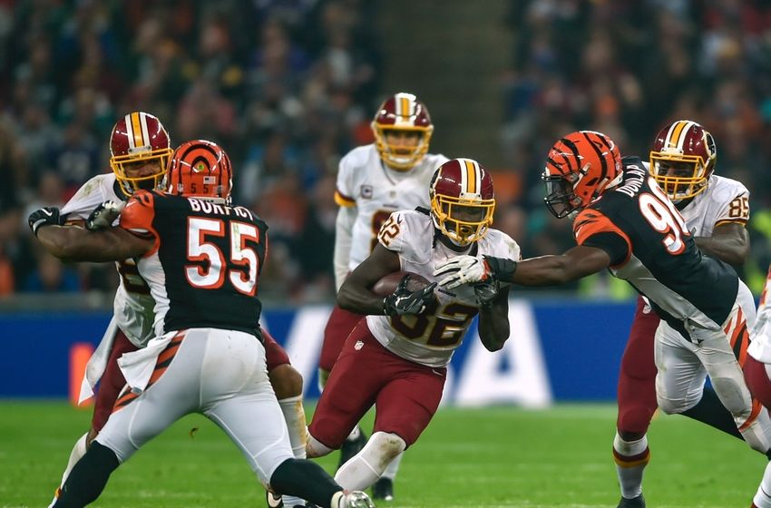 Oct 30, 2016; London, United Kingdom; Washington Redskins running back Robert Kelley (32) runs against the Cincinnati Bengals defense during the third quarter at Wembley Stadium. Mandatory Credit: Steve Flynn-USA TODAY Sports
