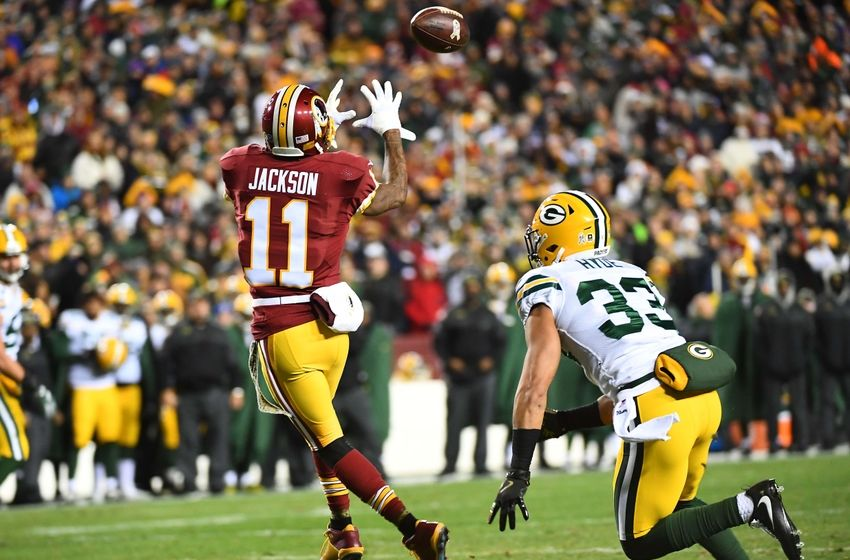 Nov 20, 2016; Landover, MD, USA; Washington Redskins wide receiver DeSean Jackson (11) scores a touchdown as Green Bay Packers strong safety Micah Hyde (33) looks on during the first half at FedEx Field. Mandatory Credit: Brad Mills-USA TODAY Sports