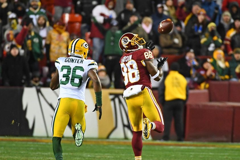 Nov 20, 2016; Landover, MD, USA; Washington Redskins wide receiver Pierre Garcon (88) catches a 70 yard touchdown pass as Green Bay Packers cornerback LaDarius Gunter (36) chases during the second half at FedEx Field. Mandatory Credit: Brad Mills-USA TODAY Sports