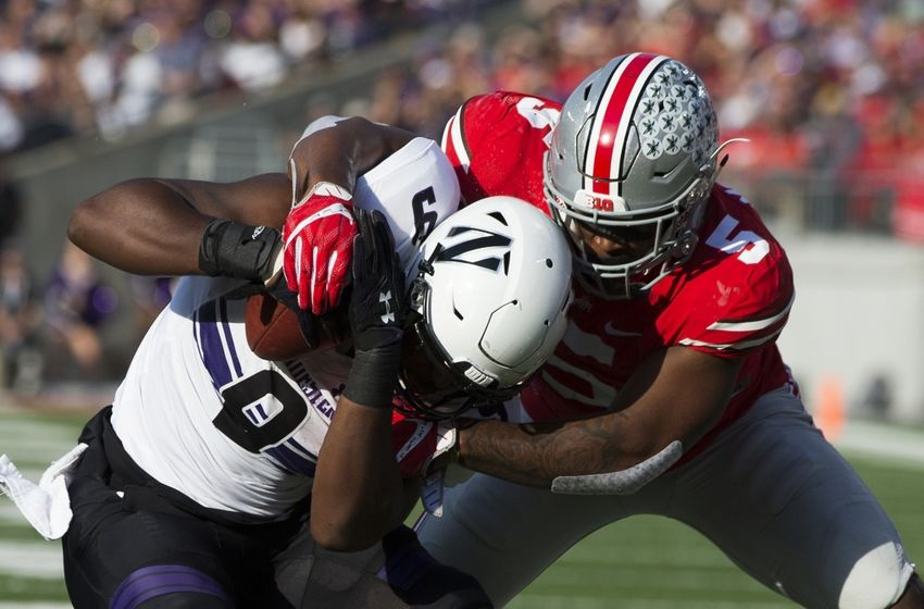Oct 29, 2016; Columbus, OH, USA; Northwestern Wildcats fullback Garrett Dickerson (9) is tackled by Ohio State Buckeyes linebacker Raekwon McMillan (5) at Ohio Stadium. Mandatory Credit: Greg Bartram-USA TODAY Sports