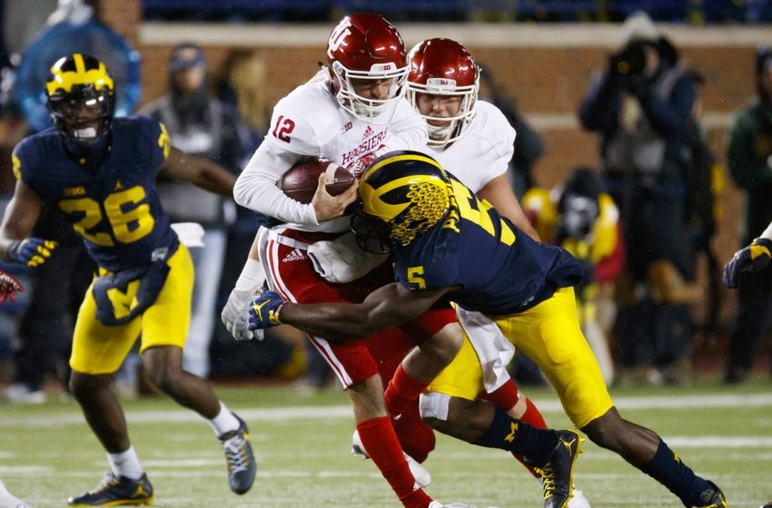 Nov 19, 2016; Ann Arbor, MI, USA; Indiana Hoosiers quarterback Zander Diamont (12) is sacked by Michigan Wolverines linebacker Jabrill Peppers (5) in the second half at Michigan Stadium. Michigan won 20-10. Mandatory Credit: Rick Osentoski-USA TODAY Sports
