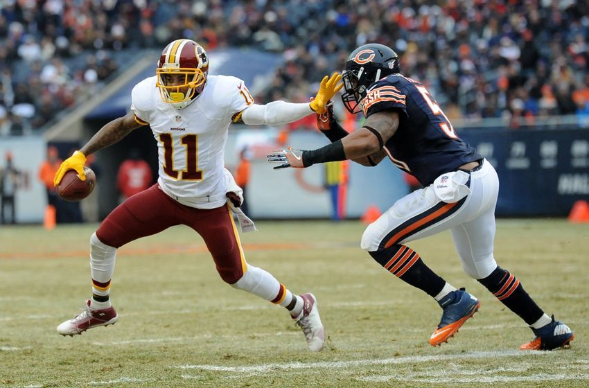 Dec 24, 2016; Chicago, IL, USA; Washington Redskins wide receiver DeSean Jackson (11) carries the ball as Chicago Bears inside linebacker Jerrell Freeman (50) defends during the first half at Soldier Field. Mandatory Credit: Patrick Gorski-USA TODAY Sports