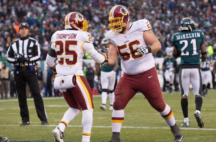 Dec 11, 2016; Philadelphia, PA, USA; Washington Redskins running back Chris Thompson (25) reacts with center John Sullivan (56) after his touchdown run against the Philadelphia Eagles during the fourth quarter at Lincoln Financial Field. The Washington Redskins won 27-22. Mandatory Credit: Bill Streicher-USA TODAY Sports