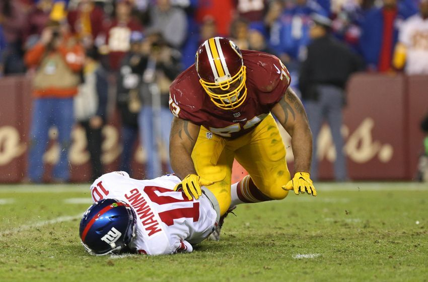 Jan 1, 2017; Landover, MD, USA; New York Giants quarterback Eli Manning (10) is sacked by Washington Redskins defensive lineman Cullen Jenkins (73) in the fourth quarter at FedEx Field. The Giants won 19-10. Mandatory Credit: Geoff Burke-USA TODAY Sports