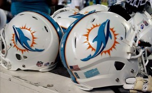Aug 24, 2013; Miami Gardens, FL, USA; Miami Dolphins helmets on the sidelines during a game against the Tampa Bay Buccaneers at Sun Life Stadium. Mandatory Credit: Robert Mayer-USA TODAY Sports