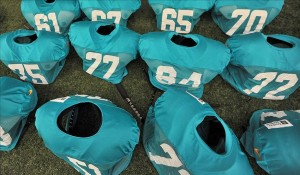 Jul 24, 2013; Davie, FL, USA; Miami Dolphins jerseys and shoulder pads are seen during training camp practice at the Doctors Hospital Training Facility at Nova Southeastern University. Mandatory Credit: Steve Mitchell-USA TODAY Sports