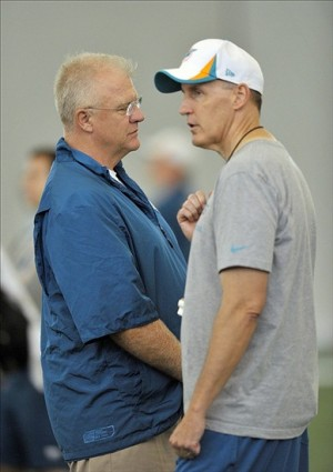 Jul 26, 2013; Davie, FL, USA; Miami Dolphins offensive coordinator Mike Sherman (left) talks with head coach Joe Philbin (right) during training camp at the Doctors Hospital Training Facility at Nova Southeastern University. Mandatory Credit: Steve Mitchell-USA TODAY Sports