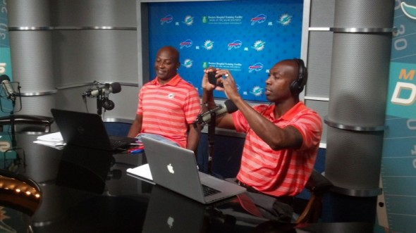 18Oct13 - Sam Madison and OJ McDuffie on the set of the FinSiders broadcast at the Miami Dolphins Training Facility. Sam Madison taking pictures of the web weekend fans as they entered the studio