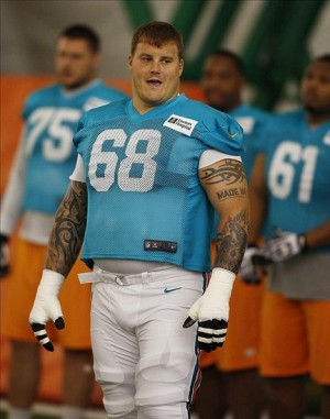 Jul 22, 2013; Davie, FL, USA; Miami Dolphins guard Richie Incognito (68) during training camp at the Doctors Hospital Training Facility at Nova Southeastern University. Mandatory Credit: Robert Mayer-USA TODAY Sports