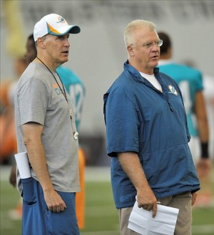 Jul 26, 2013; Davie, FL, USA; Miami Dolphins offensive coordinator Mike Sherman (right) talks with head coach Joe Philbin (left) during training camp at the Doctors Hospital Training Facility at Nova Southeastern University. Mandatory Credit: Steve Mitchell-USA TODAY Sports