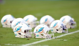 Jul 29, 2013; Miami, FL, USA; Miami Dolphins helmets are seen prior to a scrimmage at Sun Life Stadium. Mandatory Credit: Steve Mitchell-USA TODAY Sports