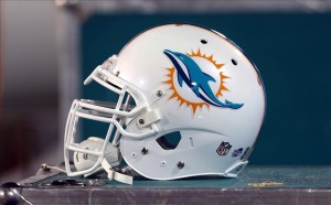 Aug 4, 2013; Canton, OH, USA; Miami Dolphins helmet with the new logo at Fawcett Stadium. Mandatory Credit: Ron Schwane-USA TODAY Sports