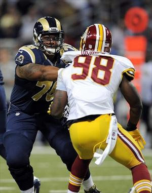 September 16, 2012; St. Louis, MO, USA; St. Louis Rams tackle Rodger Saffold (76) defends against Washington Redskins outside linebacker Brian Orakpo (98) during the first half at the Edward Jones Dome. Mandatory Credit: Jeff Curry-USA TODAY Sports
