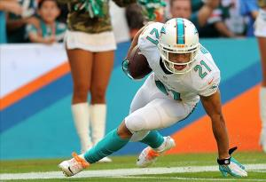 Nov 17, 2013; Miami Gardens, FL, USA; Miami Dolphins cornerback Brent Grimes (21) intercepts a pass during the first quarter against the San Diego Chargers at Sun Life Stadium. Mandatory Credit: Steve Mitchell-USA TODAY Sports