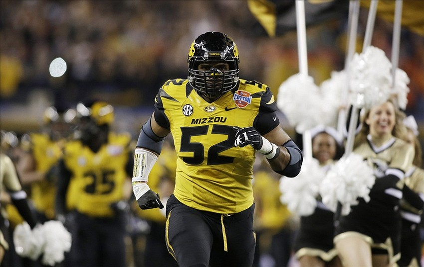 Jan 3, 2014; Arlington, TX, USA; Missouri Tigers defensive lineman Michael Sam (52) runs on the field before the game against the Oklahoma State Cowboys at the 2014 Cotton Bowl at AT&T Stadium. Missouri beat Oklahoma State 41-31. Mandatory Credit: Tim Heitman-USA TODAY Sports