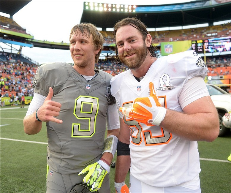 January 26, 2014; Honolulu, HI, USA; Philadelphia Eagles teammates Nick Foles (left) and Evan Mathis pose after the 2014 Pro Bowl at Aloha Stadium. Team Rice defeated Team Sanders 22-21. Mandatory Credit: Kirby Lee-USA TODAY Sports