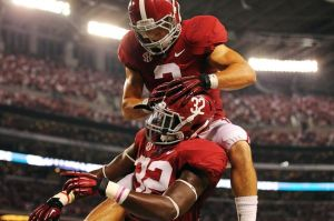 Sep 1, 2012; Arlington, TX, USA; Alabama Crimson Tide linebacker C.J. Mosely (32) celebrates scoring a touchdown with defensive back Vinnie Sunseri (3) during the second quarter at Cowboys Stadium. Mandatory Credit: Kevin Jairaj-USA TODAY Sports
