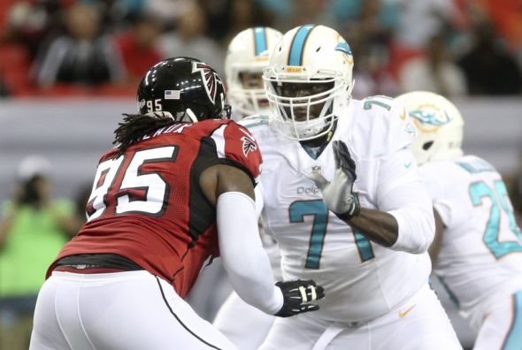 Aug 8, 2014; Atlanta, GA, USA; Miami Dolphins tackle Branden Albert (71) blocks Atlanta Falcons defensive tackle Jonathan Babineaux (95) in the first half of their game at Georgia Dome. Mandatory Credit: Jason Getz-USA TODAY Sports