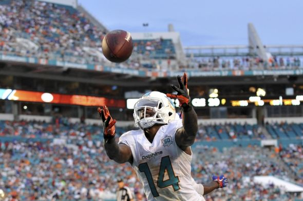 Sep 27, 2015; Miami Gardens, FL, USA; Miami Dolphins wide receiver Jarvis Landry (14) is unable to make a catch during the second half against the Buffalo Bills at Sun Life Stadium. Mandatory Credit: Steve Mitchell-USA TODAY Sports