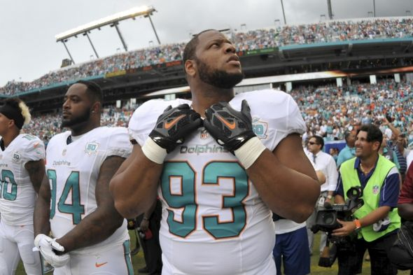 Sep 27, 2015; Miami Gardens, FL, USA; Miami Dolphins defensive tackle Ndamukong Suh (93) looks  on before a game against the Buffalo Bills at Sun Life Stadium. Mandatory Credit: Steve Mitchell-USA TODAY Sports