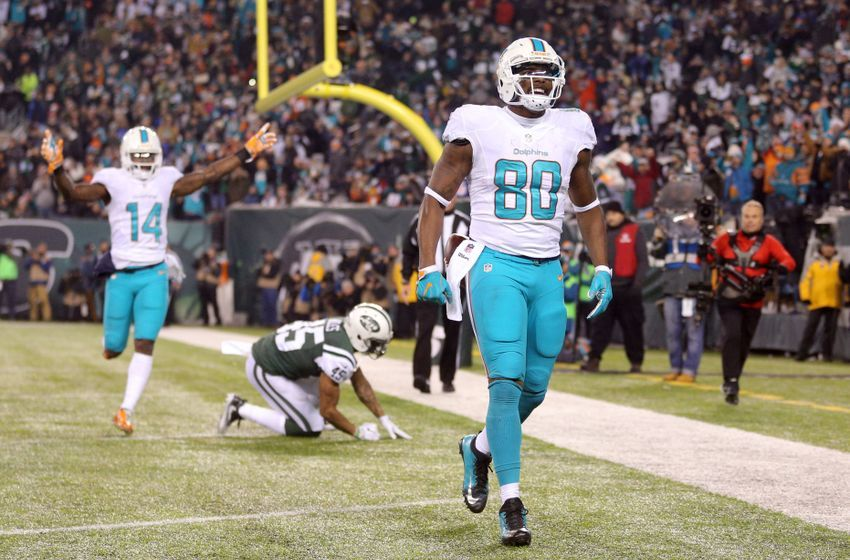 Dec 17, 2016; East Rutherford, NJ, USA; Miami Dolphins tight end Dion Sims (80) celebrates his touchdown against the New York Jets during the third quarter at MetLife Stadium. Mandatory Credit: Brad Penner-USA TODAY Sports