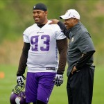 May 29, 2013; Eden Prairie, MN, USA; Minnesota Vikings defensive tackle Kevin Williams (93) laughs with head coach Leslie Frazier at the Minnesota Vikings OTA at Winter Park. Mandatory Credit: Bruce Kluckhohn-USA TODAY Sports