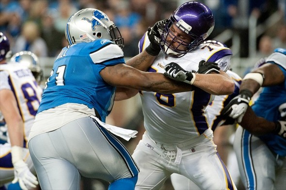 Dec 11, 2011; Detroit, MI, USA; Detroit Lions defensive tackle Sammie Lee Hill (91) grabs the helmet of Minnesota Vikings guard Steve Hutchinson (76) during the first half at Ford Field. Mandatory Credit: Tim Fuller-USA TODAY Sports