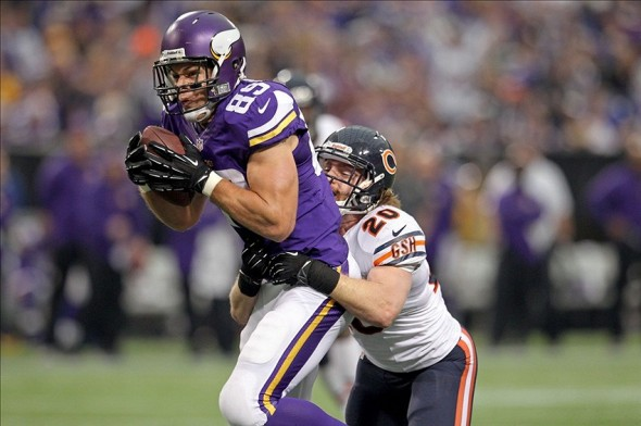 Dec 1, 2013; Minneapolis, MN, USA; Minnesota Vikings tight end John Carlson (89) is tackled by Chicago Bears safety Craig Steltz (20) during the third quarter at Mall of America Field at H.H.H. Metrodome. Mandatory Credit: Brace Hemmelgarn-USA TODAY Sports
