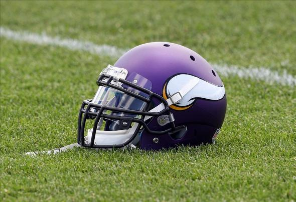 Jul 26, 2013; Mankato, MN, USA; Minnesota Vikings helmet sits in the grass during training camp at Minnesota State University. Mandatory Credit: Brace Hemmelgarn-USA TODAY Sports
