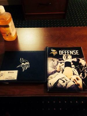 Scott Crichton's defensive playbook, name tag, iPad, and juice.