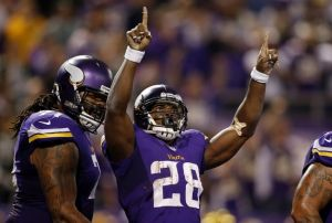 Oct 27, 2013; Minneapolis, MN, USA; Minnesota Vikings running back Adrian Peterson (28) celebrates his touchdown run against the Green Bay Packers in the second quarter at Mall of America Field at H.H.H. Metrodome. Mandatory Credit: Bruce Kluckhohn-USA TODAY Sports