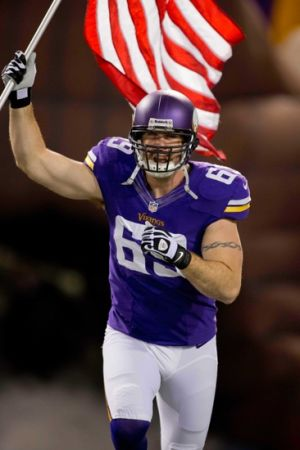 Nov 7, 2013; Minneapolis, MN, USA; Minnesota Vikings defensive end Jared Allen (69) brings out a flag during introductions before the game with the Washington Redskins at Mall of America Field at H.H.H. Metrodome. The Vikings win 34-27. Mandatory Credit: Bruce Kluckhohn-USA TODAY Sports