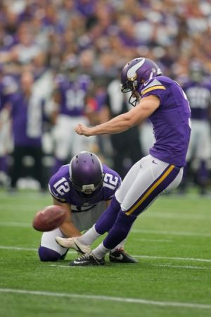 Sep 22, 2013; Minneapolis, MN, USA; Minnesota Vikings kicker Blair Walsh (3) kicks a 43 yard field goal as punter Jeff Locke (12) holds in the second quarter against the Cleveland Browns at Mall of America Field at H.H.H. Metrodome. The Browns win 31-27. Mandatory Credit: Bruce Kluckhohn-USA TODAY Sports