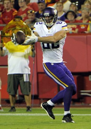 Aug 23, 2014; Kansas City, MO, USA; Minnesota Vikings tight end Kyle Rudolph (82) catches a pass against the Kansas City Chiefs in the first half at Arrowhead Stadium. Mandatory Credit: John Rieger-USA TODAY Sports