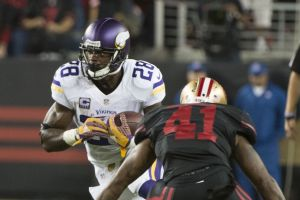 September 14, 2015; Santa Clara, CA, USA; Minnesota Vikings running back Adrian Peterson (28) runs with the football against San Francisco 49ers strong safety Antoine Bethea (41) during the second quarter at Levi
