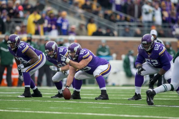 Dec 7, 2014; Minneapolis, MN, USA; Minnesota Vikings tackle Mike Harris (79) and guard Joe Berger (61) and center John Sullivan (65) and guard Vladimir Ducasse (62) prepare to block against the New York Jets in the third quarter at TCF Bank Stadium. The Vikings win 30-24. Mandatory Credit: Bruce Kluckhohn-USA TODAY Sports